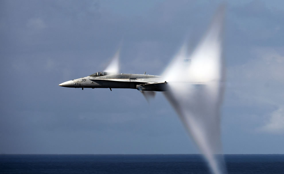 FA-18C-Hornet-assigned-to-Strike-Fighter-Squadron-VFA-113-breaks-the-sound-barrier-during-an-air-power-demonstration-over-the-Nimitz-class-aircraft-carrier-USS-Carl-Vinson